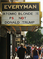 © Licensed to London News Pictures. 14/08/2017. London, UK. The Everyman Cinema in Baker Street mocks US President Donald Trump on it's billboard for Charlize Theron's movie 'Atomic Blond' . Photo credit: David Hughes/LNP
