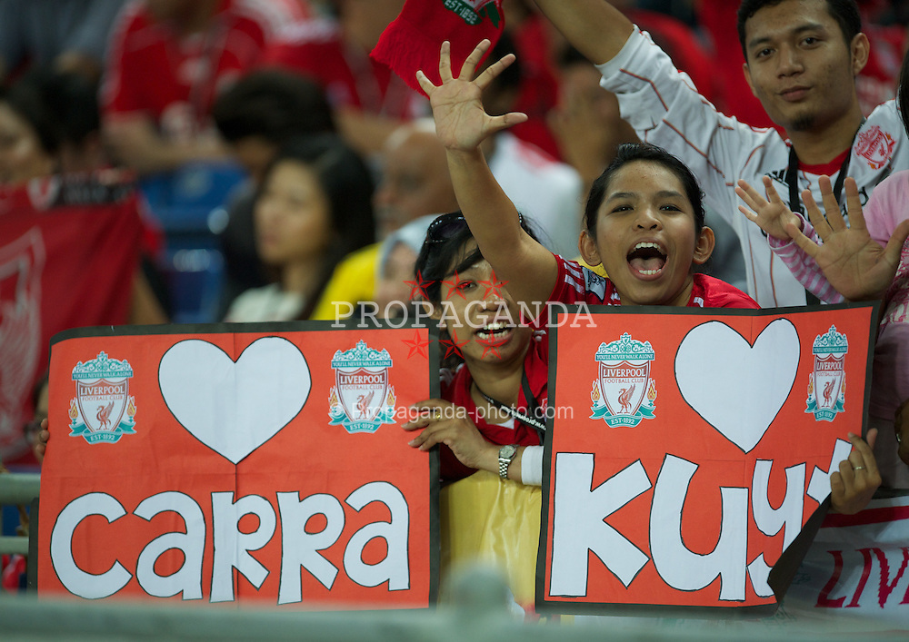 KUALA LUMPUR, MALAYSIA - Thursday, July 14, 2011: Malaysian Liverpool supporters during a training session at the National Stadium Bukit Jalil in Kuala Lumpur ahead of their second pre-season friendly match on day four of the club's Asia Tour. (Photo by David Rawcliffe/Propaganda)