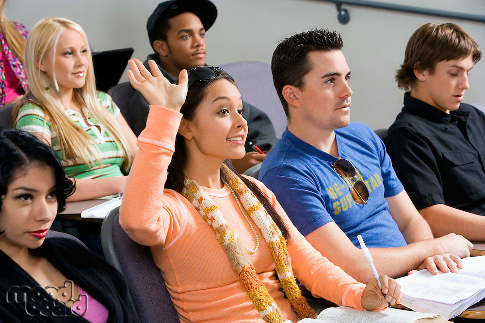 Student raising hand during class lecture