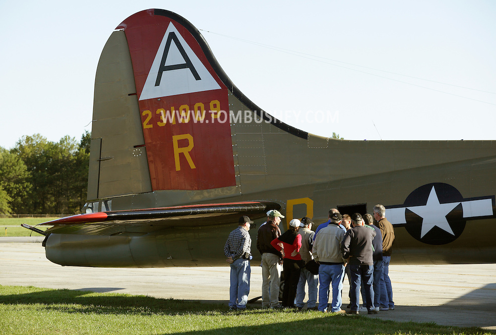 Montgomery, New York - People gather at the rear of a B-17 Flying Fortress Bomber from Collings Foundation on display as part of the Wings of Freedom Tour before taking a ride on the plane at Orange County Airport on Oct. 2, 2010.
