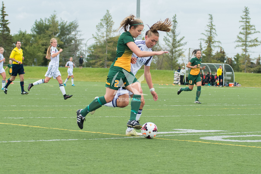 2nd year forward Kirsten Finley (2) of the Regina Cougars jostles with Brooklyn Tidder, Mid/Forward (11) of the Trinity Western Spartans during the Women's Soccer home game on September 11 at U of R Field. Credit: Arthur Ward/Arthur Images