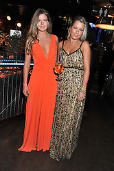 Left to right, KATIE READMAN and DAVINA HARBORD at the Wild for WSPA dinner in aid of the charity World Society for the Protection of Animals held at Under The Bridge, Stamford Bridge, Fulham Road, London on 23rd February 2012.