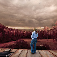 A woman standing on decking