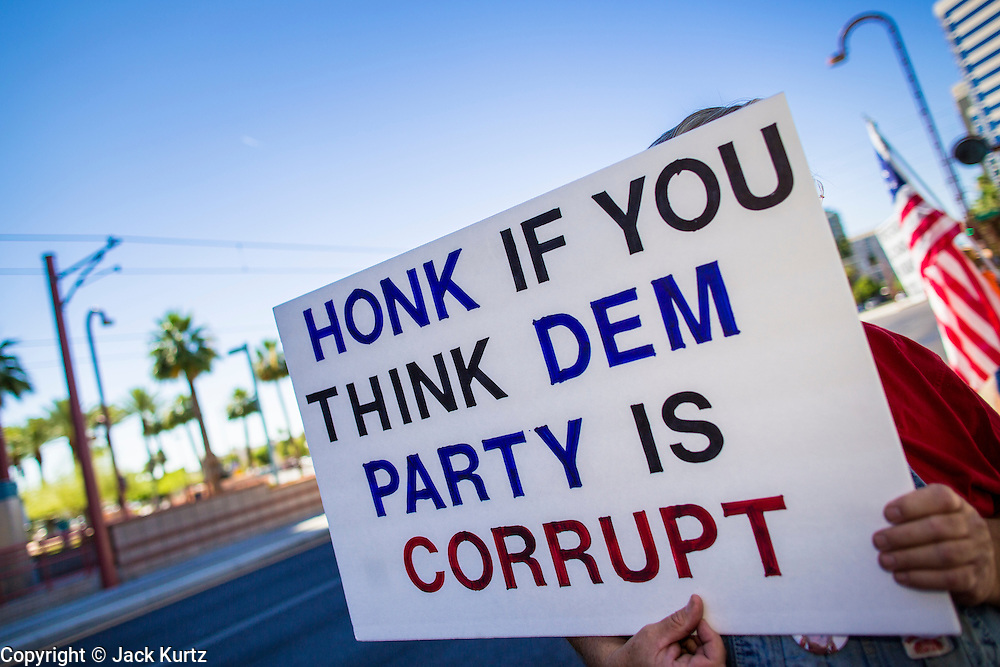 08 JUNE 2012 - PHOENIX, AZ:   A protester pickets the Democratic party headquarters in Phoenix. About 30 members of the Arizona Democratic Party picketed party headquarters Friday to show their unhappiness with party leadership. They claim the party, or party endorsed candidates, is accepting money from the American Legislative Exchange Council (ALEC) and is not properly supporting Democratic candidates not endorsed by the party, even during the primaries.           PHOTO BY JACK KURTZ