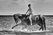 The Household Cavalry Mounted Regiment exercise their horses on Holkham beach during their annual summer camp in Norfolk, England