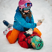 Jade Goodrich smacks her brother Micah in the face with her ski glove at Jackson Hole Mountain Resort, Teton Village, Wyoming.