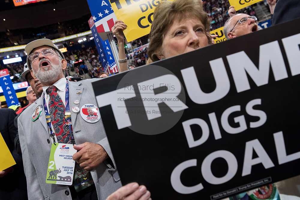 Coal supporters hold up signs that say Trump Digs Coal during an address on coal during the second day of the Republican National Convention via live video link July 19, 2016 in Cleveland, Ohio. Earlier in the day the delegates formally nominated Donald J. Trump for president.