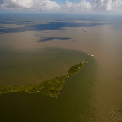 A small barrier island is seen in the Gulf of Mexico off the coast of Louisiana, U.S., on Monday, July 26, 2010. Photographer: Derick E. Hingle