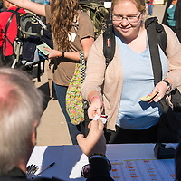Students and Lifelong Learners submit their passports for safekeeping during Embarkation day for the Semester at Sea Spring 2014 Voyage, January 10th 2014, in Ensenada, Mexico. Ashley Davis from Marist College receives her shipboard identification card during embarkation.