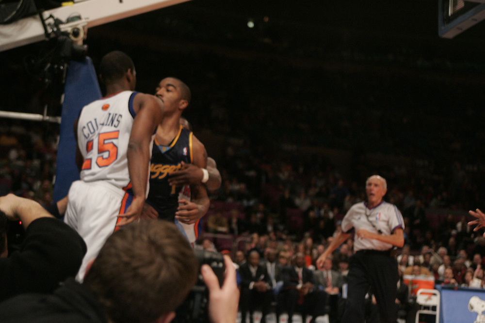 J.R. Smith #1 of the Denver Nuggets gets in face of Mardy Collins #25 of the New York Knicks after a foul that led to a fightat Madison Square Garden, New York City, on Saturday 16 December 2006 (Andrew Gombert for The New York Times)