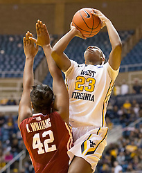West Virginia Mountaineers guard Bria Holmes (23) shoots over Oklahoma Sooners forward Kaylon Williams (42) during the first half at the WVU Coliseum.