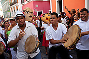 Musicians parade in the Festival of San Sebastian in San Juan, Puerto Rico.