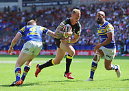 Kevin Brown of Warrington Wolves breaks through the Leeds defence before scoring the third try against Leeds Rhinos during the Ladbrokes Challenge Cup Semi Final match at the Macron Stadium Stadium, Bolton.<br /> Picture by Michael Sedgwick/Focus Images Ltd +44 7900 363072<br /> 05/08/2018