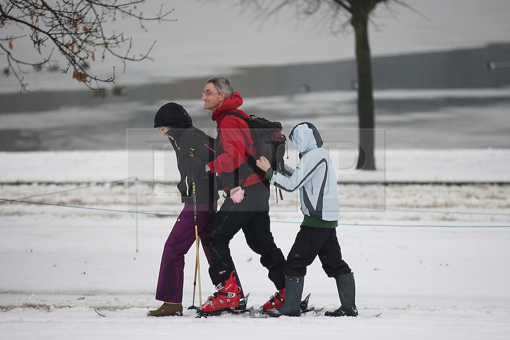 © Licensed to London News Pictures. 05/02/2012. LONDON, UK. Two children hitch a lift with their father as he skis through a snowy Hyde Park in London today (05/02/12).  Millions of Britons woke up to a snowy Sunday after heavy snow fall covered much of the UK. Photo credit: Matt Cetti-Roberts/LNP