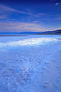 Flooded salt pan under the Funeral Mountains at dawn, Death Valley National Park, California