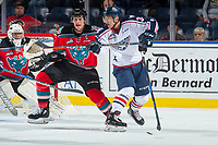 KELOWNA, CANADA - OCTOBER 27: Sasha Mutala #34 of the Tri-City Americans stick checks Cal Foote #25 as he tries to block a shot on the net of James Porter #1 of the Kelowna Rockets  on October 27, 2017 at Prospera Place in Kelowna, British Columbia, Canada.  (Photo by Marissa Baecker/Shoot the Breeze)  *** Local Caption ***