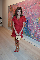 Blogger Rosie Thomas at a preview of an exhibition of art by Sassan Behnam-Bakhtiar entitled 'Oneness Wholeness' held at the Saatchi Gallery, Duke of York's HQ, King's Rd, London, England. 14 May 2018.