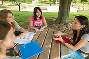 Ohio University Zanesville students converse at a picnic table on the regional campus's green.