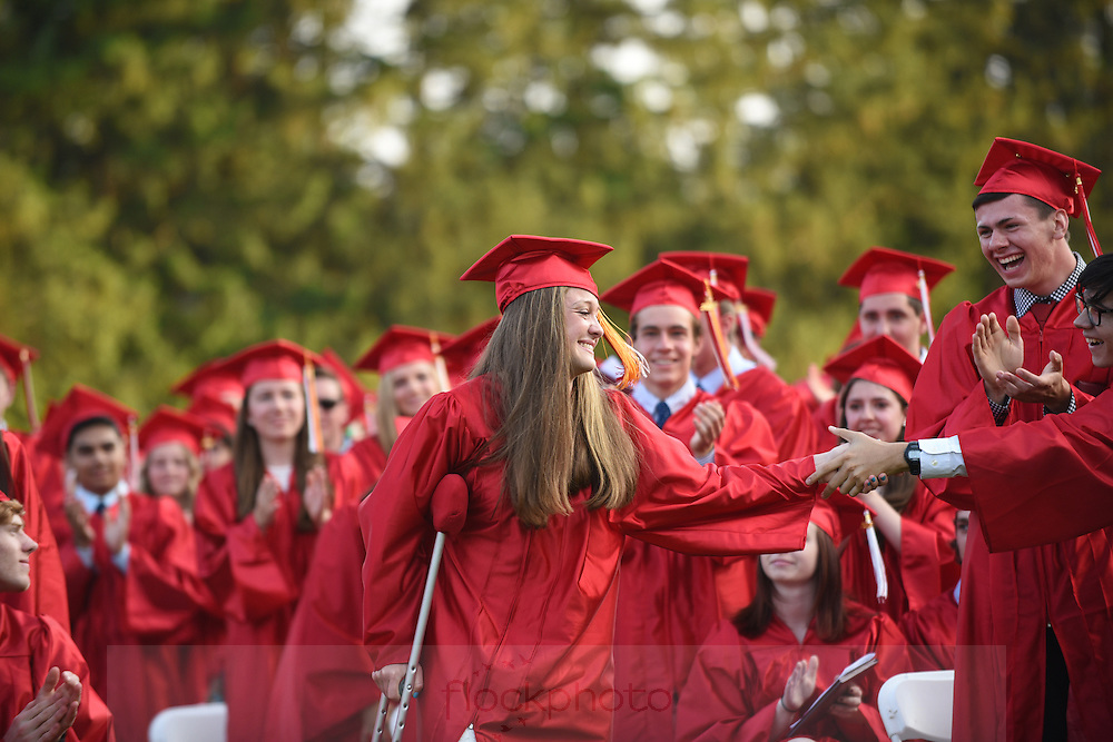 Nicole Frontero is congratulated by her classmates after being announced as a recipient of the Senior Cup during the Wellesley High School class of 2016 graduation ceremony, June 3, 2016.<br /> Wicked Local staff photo / Kate Flock