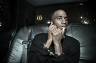 December 26th 2011,<br /> A suspect calls his family from the back of the police car on his way to central lockup after being booked for tossing a gun and runing away from officer DeSalvo. New Orleans crime rate is among the highest in America and is considered to be one of the most dangerous cities in the world.