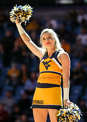 Dec 16, 2017; Morgantown, WV, USA; A West Virginia Mountaineers cheerleader performs before the game against the Wheeling Jesuit Cardinals at WVU Coliseum. Mandatory Credit: Ben Queen-USA TODAY Sports