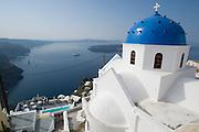 Blue church cupola at Imerovigli. View over Thira and the Caldera, Sea Cloud moored below.