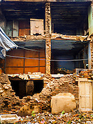 06 AUGUST 2015 - KATHMANDU, NEPAL:      The exterior wall of this home in the Thamel section of Kathmandu collapsed in the Nepal Earthquake. The Nepal Earthquake on April 25, 2015, (also known as the Gorkha earthquake) killed more than 9,000 people and injured more than 23,000. It had a magnitude of 7.8. The epicenter was east of the district of Lamjung, and its hypocenter was at a depth of approximately 15 km (9.3 mi). It was the worst natural disaster to strike Nepal since the 1934 Nepal–Bihar earthquake. The earthquake triggered an avalanche on Mount Everest, killing at least 19. The earthquake also set off an avalanche in the Langtang valley, where 250 people were reported missing. Hundreds of thousands of people were made homeless with entire villages flattened across many districts of the country. Centuries-old buildings were destroyed at UNESCO World Heritage sites in the Kathmandu Valley, including some at the Kathmandu Durbar Square, the Patan Durbar Squar, the Bhaktapur Durbar Square, the Changu Narayan Temple and the Swayambhunath Stupa. Geophysicists and other experts had warned for decades that Nepal was vulnerable to a deadly earthquake, particularly because of its geology, urbanization, and architecture.  PHOTO BY JACK KURTZ