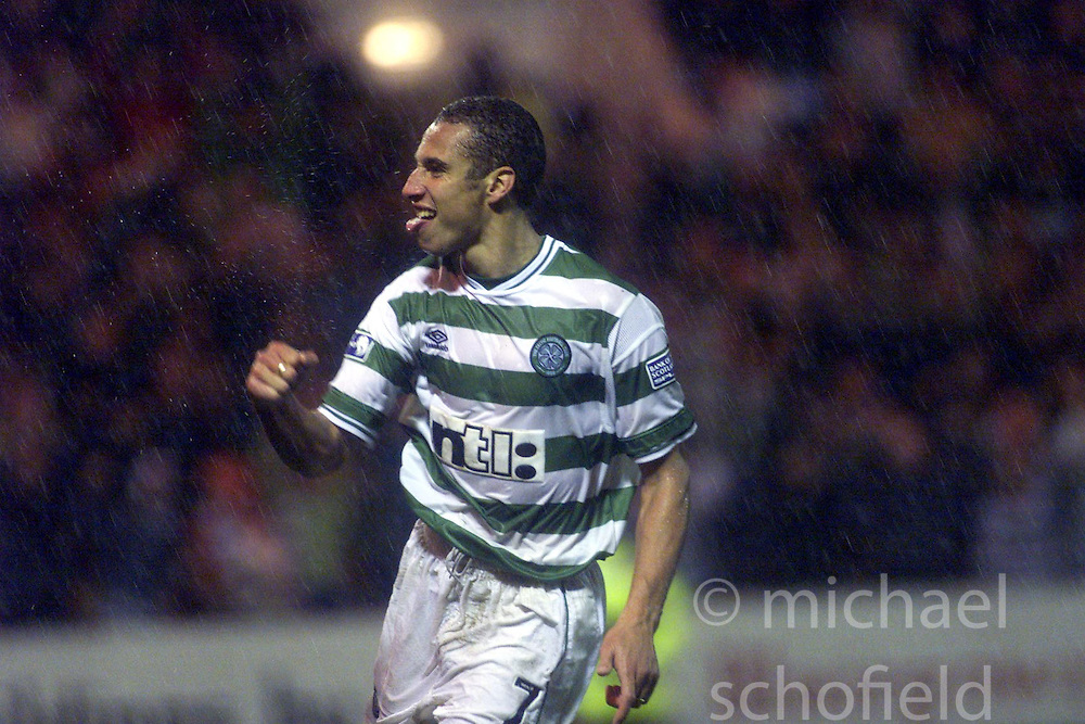 Henrik Larsson celebrates scoring a goal from the penalty spot during a St Johnstone v Celtc game in 2000..