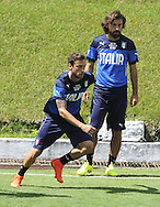 Claudio Marchsio (left) and Andrea Pirlo pictured during Italy training at Portobello Resort, Natal<br /> Picture by Stefano Gnech/Focus Images Ltd +39 333 1641678<br /> 22/06/2014