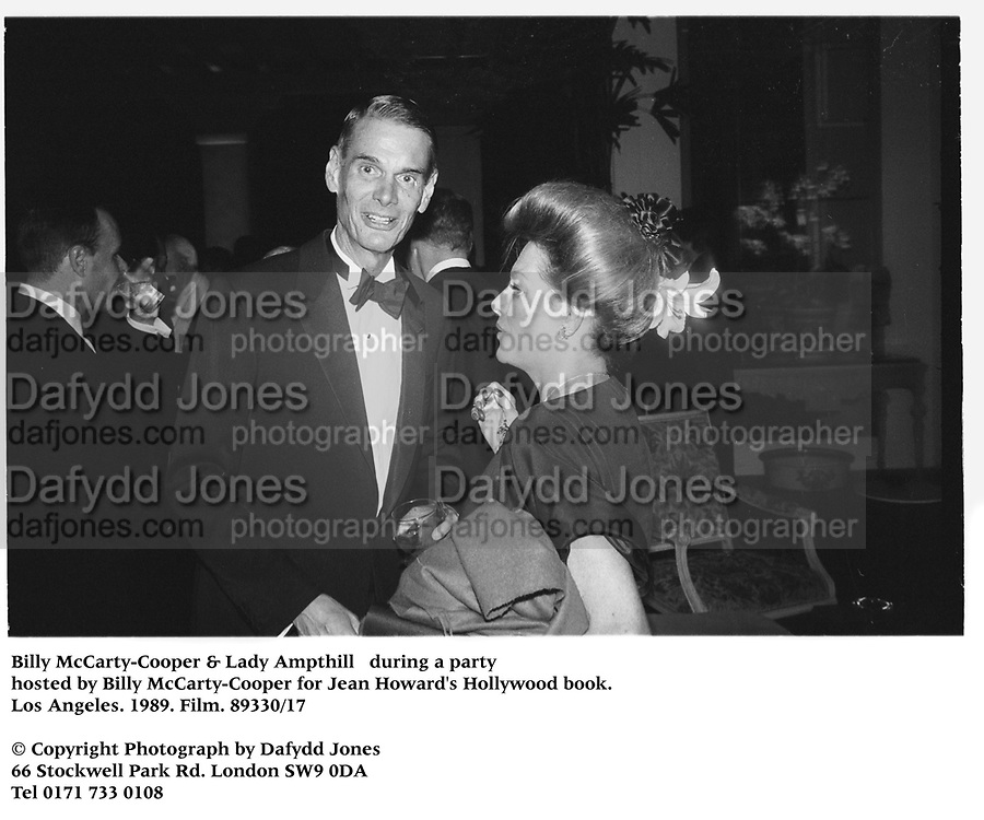 Billy McCarty-Cooper & Lady Ampthill   during a party hosted by Billy McCarty-Cooper for Jean Howard's Hollywood book. Los Angeles. 1989. Film.89330/17<br /><br />© Copyright Photograph by Dafydd Jones<br />66 Stockwell Park Rd. London SW9 0DA<br />Tel 0171 733 0108