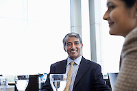 Business man looking at colleague smiling