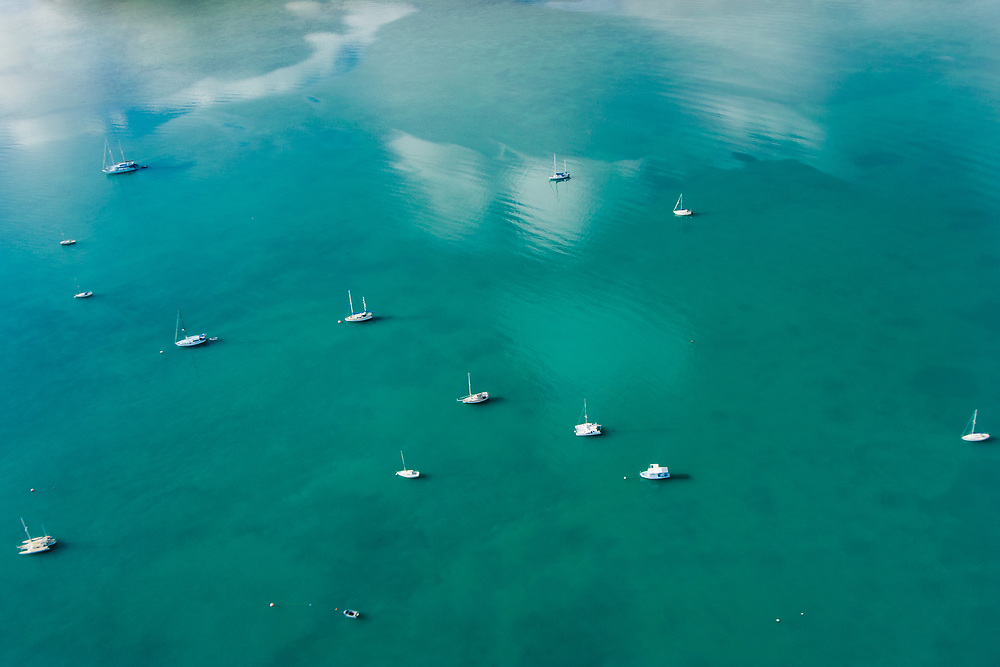 An aerial shot of boats at the Whitsundays Coast,  Queensland, Australia