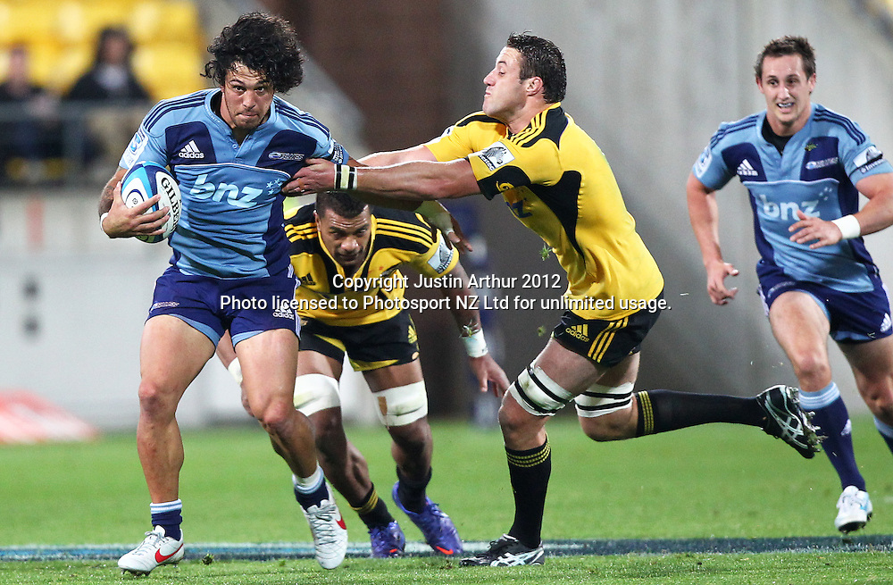 Blues' Rene Ranger in action as Hurricanes' Jeremy Thrush looks to make the tackle during the 2012 Super Rugby season, Hurricanes v Blues at Westpac Stadium, Wellington, New Zealand on Friday 4 May 2012. Photo: Justin Arthur / photosport.co.nz
