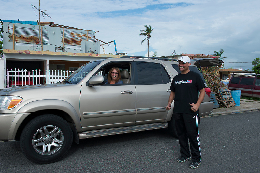 Toa Baja, PR, November 10, 2017--Eric Rossner and Wanda Pagán are part of a team of faculty and staff of Escuela Delia Cabán who continue to distribute water and emergency relief in Tao Baja, PR neighborhoods still without power and water 50 days after Hurricane Maria.  Escuela Delia Cabán has served as a distribution point for the Puerto Rico Recovery Fund's emergency relief efforts since it was established days after the storm hit September 20, 2017.  Photo by Lori Waselchuk/BRAF