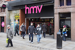 © Licensed to London News Pictures . 08/02/2013 . Manchester , UK . Shoppers walk passed troubled retailer HMV on Manchester's Market Street . Photo credit : Joel Goodman/LNP