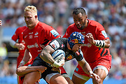 Saracens back row Billy Vunipola (8) comes in to tackle Exeter Chiefs fullback Jack Nowell (15) during the Gallagher Premiership Rugby Final match between Exeter Chiefs and Saracens at Twickenham, Richmond, United Kingdom on 1 June 2019.