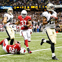 Sep 22, 2013; New Orleans, LA, USA; New Orleans Saints wide receiver Robert Meachem (17) catches a touchdown over Arizona Cardinals cornerback Jerraud Powers (25) during a game at Mercedes-Benz Superdome. The Saints defeated the Cardinals 31-7. Mandatory Credit: Derick E. Hingle-USA TODAY Sports