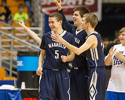 Magnolia players celebrate beating Greater Beckley Christian during a semi-final game at the Charleston Civic Center.