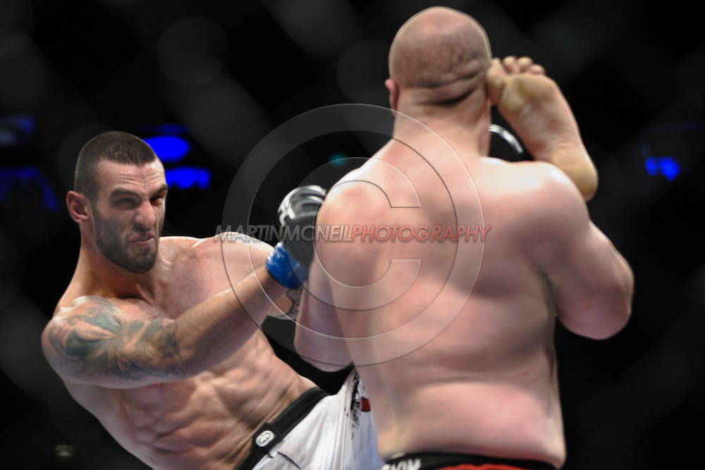 """LONDON, ENGLAND, OCTOBER 2010:  Vinicius Queiroz laucnes a kick to the head of Rob Broughton during """"UFC 120: Bisping vs. Akiyama"""" inside the O2 Arena in Greenwich, London"""