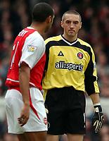 Photo. Javier Garcia<br />02/03/2003 Arsenal v Charlton, FA Barclaycard Premiership, Highbury<br />Dean Kiely and Thierry Henry eyeball eachother