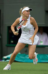 LONDON, ENGLAND - Tuesday, June 21, 2011: Caroline Wozniacki (DEN), wearing a questionable Stella McCartney dress, in action during the Ladies' Singles 1st Round match on day two of the Wimbledon Lawn Tennis Championships at the All England Lawn Tennis and Croquet Club. (Pic by David Rawcliffe/Propaganda)