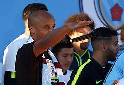 Manchester City's Vincent Kompany drops the microphone during the press conference at Hampden Park, Glasgow.