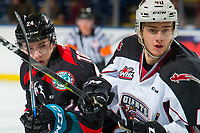 KELOWNA, CANADA - OCTOBER 3: Kyle Topping #24 of the Kelowna Rockets stick checks Milos Roman #40 of the Vancouver Giants after the face off  on October 3, 2018 at Prospera Place in Kelowna, British Columbia, Canada.  (Photo by Marissa Baecker/Shoot the Breeze)  *** Local Caption ***