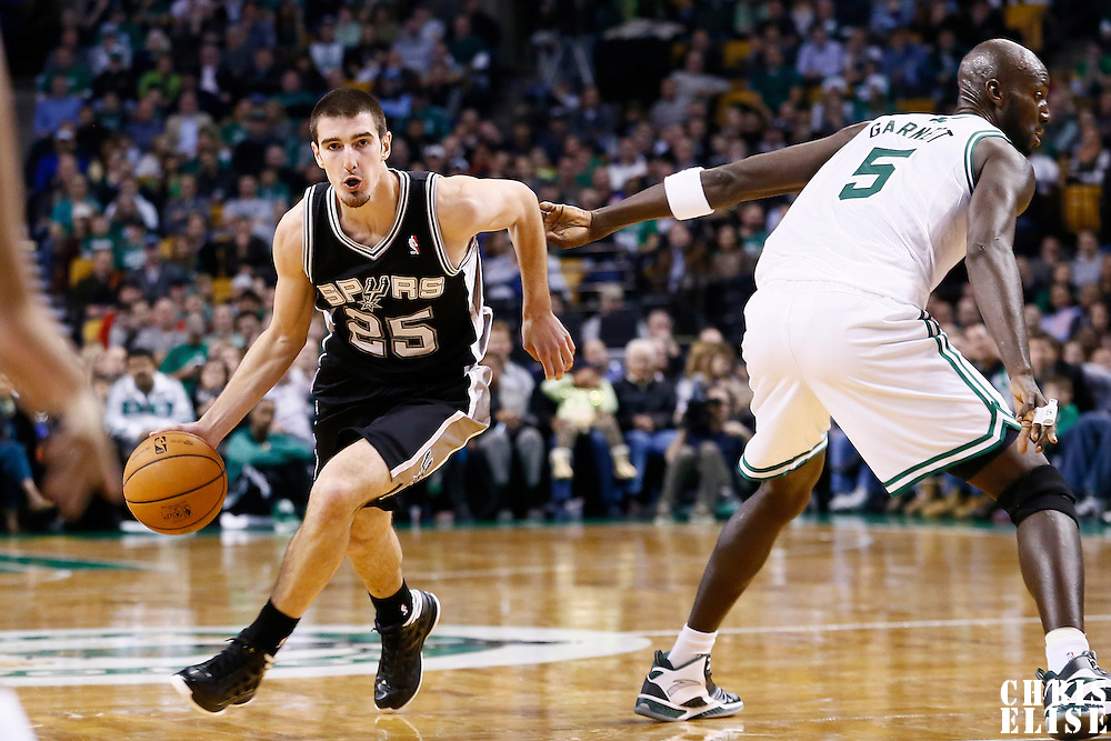 21 November 2012: San Antonio Spurs point guard Nando de Colo (25) drives past Boston Celtics power forward Kevin Garnett (5) during the San Antonio Spurs 112-100 victory over the Boston Celtics at the TD Garden, Boston, Massachusetts, USA.
