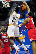 Feb. 27, 2011; Cleveland, OH, USA; Cleveland Cavaliers power forward J.J. Hickson (21) is fouled by Philadelphia 76ers shooting guard Andre Iguodala (9) during the fourth quarter at Quicken Loans Arena. The 76ers beat the Cavaliers 95-91.Mandatory Credit: Jason Miller-US PRESSWIRE