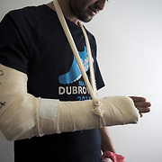 I met M. in AC Krnjaca refugee camp just coming from an hospital. During the night he was trying to cross to Croatia and was beaten,. His arm was fractured. He recounts: 'I was going to cross into Croatia border coming from Serbia. I had a lot of beating, bones broken. They left me in pain just lying on the floor, like that.' M., AC Krnjaca refugee camp, Belgrade, Serbia.
