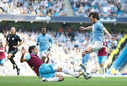 MANCHESTER, ENGLAND - Sunday, May 1, 2011: Manchester City's David Silva and West Ham United's Manuel Da Costa during the Premiership match at the City of Manchester Stadium. (Photo by David Tickle/Propaganda)