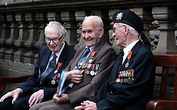 D-Day 75th anniversary, Edinburgh, Friday 6th June 2019<br /> <br /> A service to commemorate the 75th anniversary of the D-Day<br /> landings was organised by Armed Forces charity Legion<br /> Scotland and The French Consulate General.<br /> <br /> It was attended by 15 D-Day veterans, 4 of whom received the Knight of the Légion d'Honneur Cross, serving personnel, various dignitaries and Graeme Dey, the Scottish Government's Minister for Parliamentary Business and<br /> Veterans.<br /> <br /> Pictured:  David Livingston (97, Royal Navy, centre) received the medal and is flanked by previous recipients Jack Adamson (100, Black Watch, right) and Robert Paton (94, wireless operator, left) <br /> <br /> Alex Todd | Edinburgh Elite media