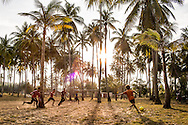Football match in a coconut grove, outside Kota Bharu, Kelantan