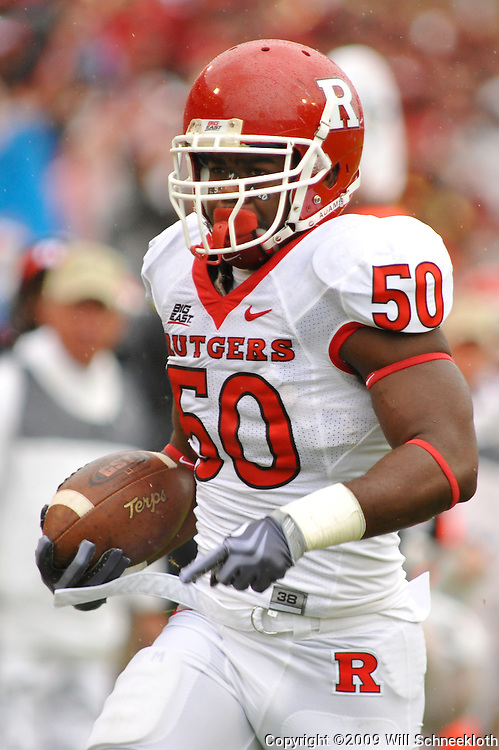 Sep 26, 2009; College Park, MD, USA; Rutgers linebacker Antonio Lowery (50) returns an interception for a touchdown on the first play of Rutgers' 34-13 victory over Maryland in NCAA college football at Byrd Stadium.